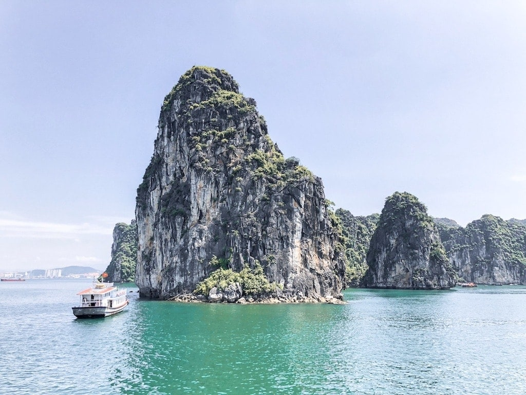 Best Halong Bay Cruise: Boat near limestone karst